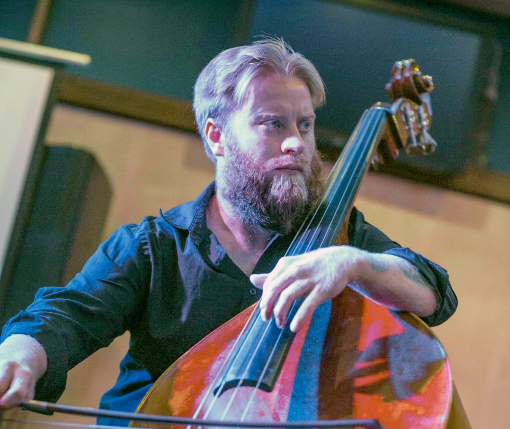 Elsen Price playing a double bass